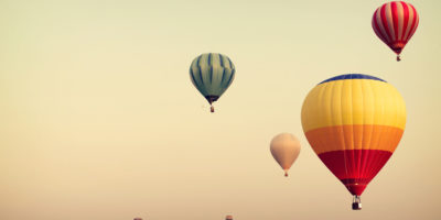 Hot air balloon on sky with fog, vintage and retro instagram filter effect style